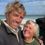 Chris and Elayne posing on a beach